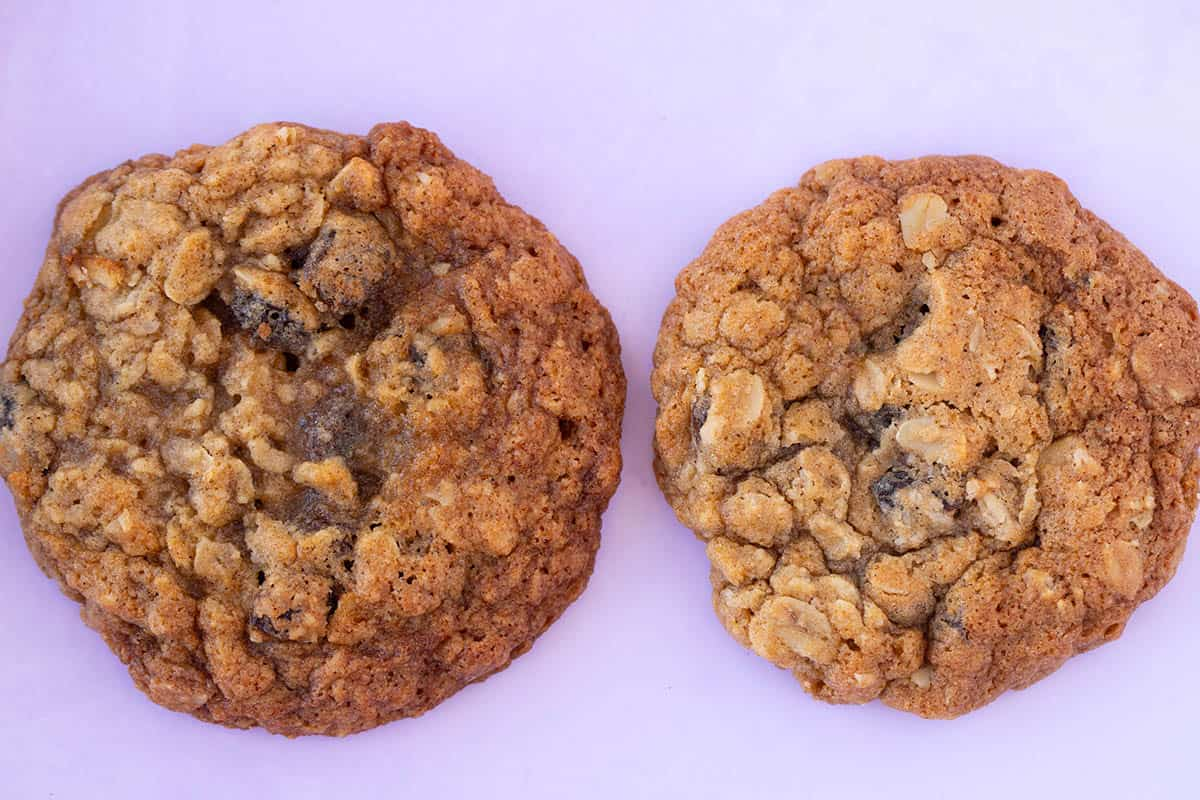 Two Oatmeal Raisin Cookies that differ in size sitting next to each other