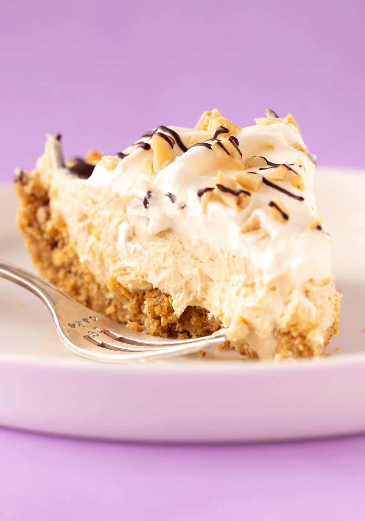 A slice of Peanut Butter Pie on a white plate