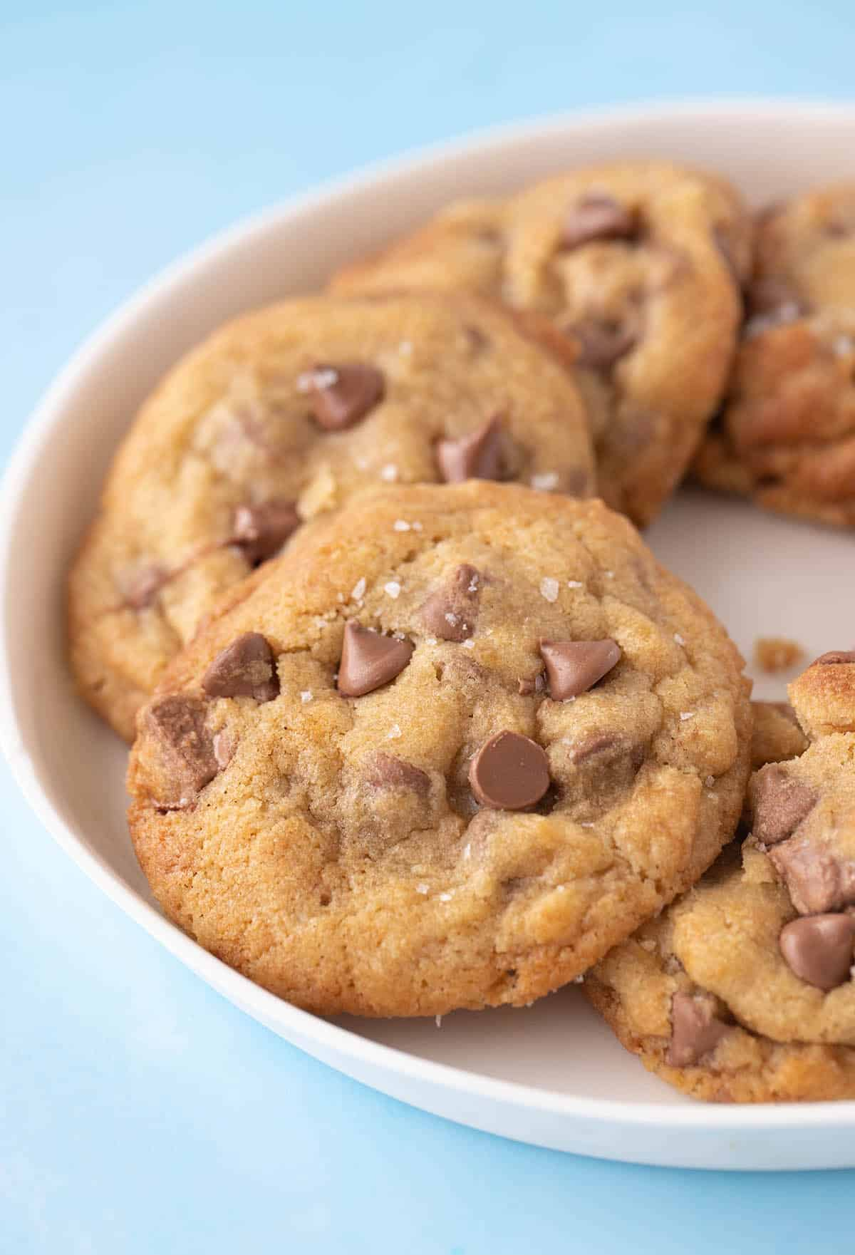 A white plate of homemade Brown Butter Chocolate Chip Cookies