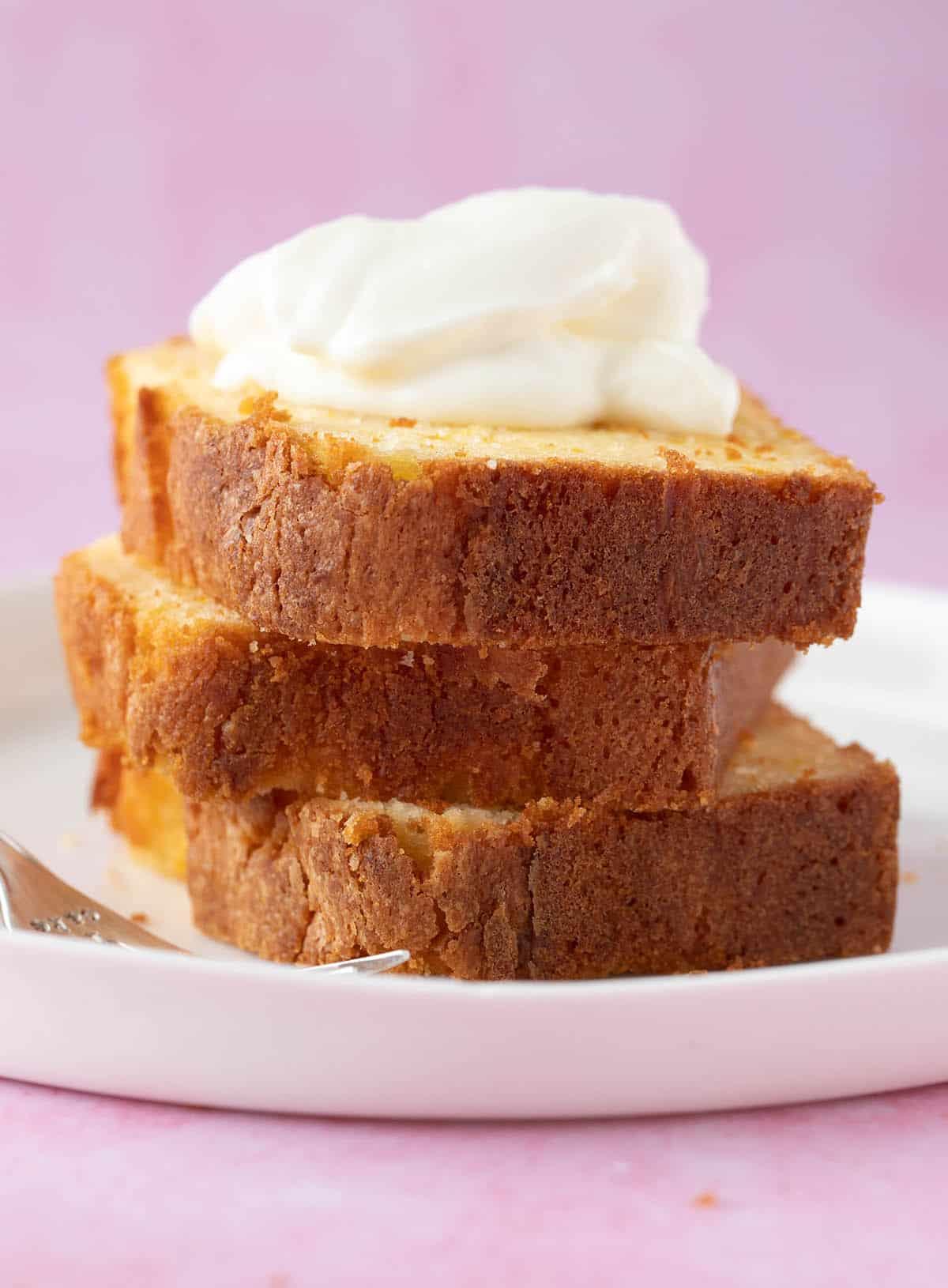Slices of Gluten Free Orange Cake on a white plate