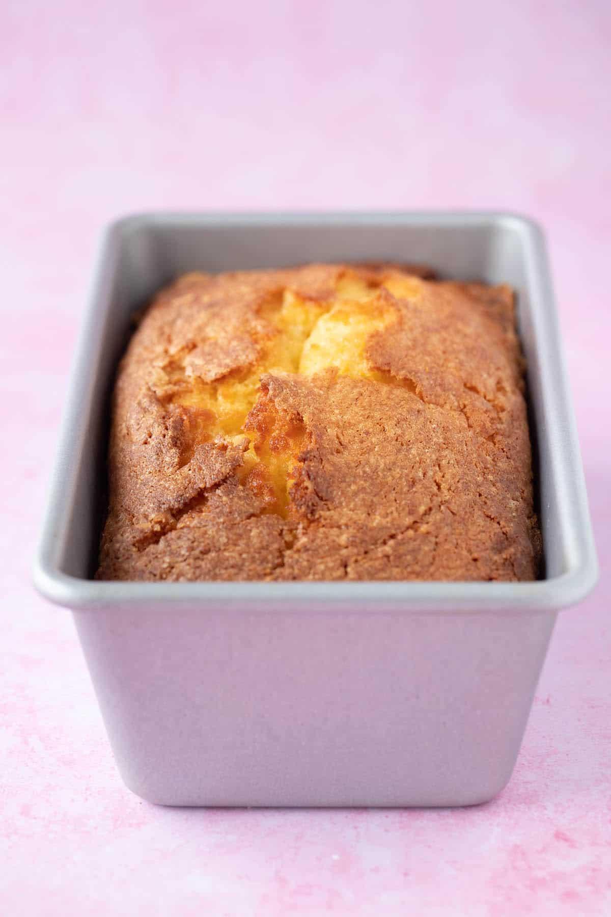 A homemade Gluten Free Orange Cake sitting in a cake pan