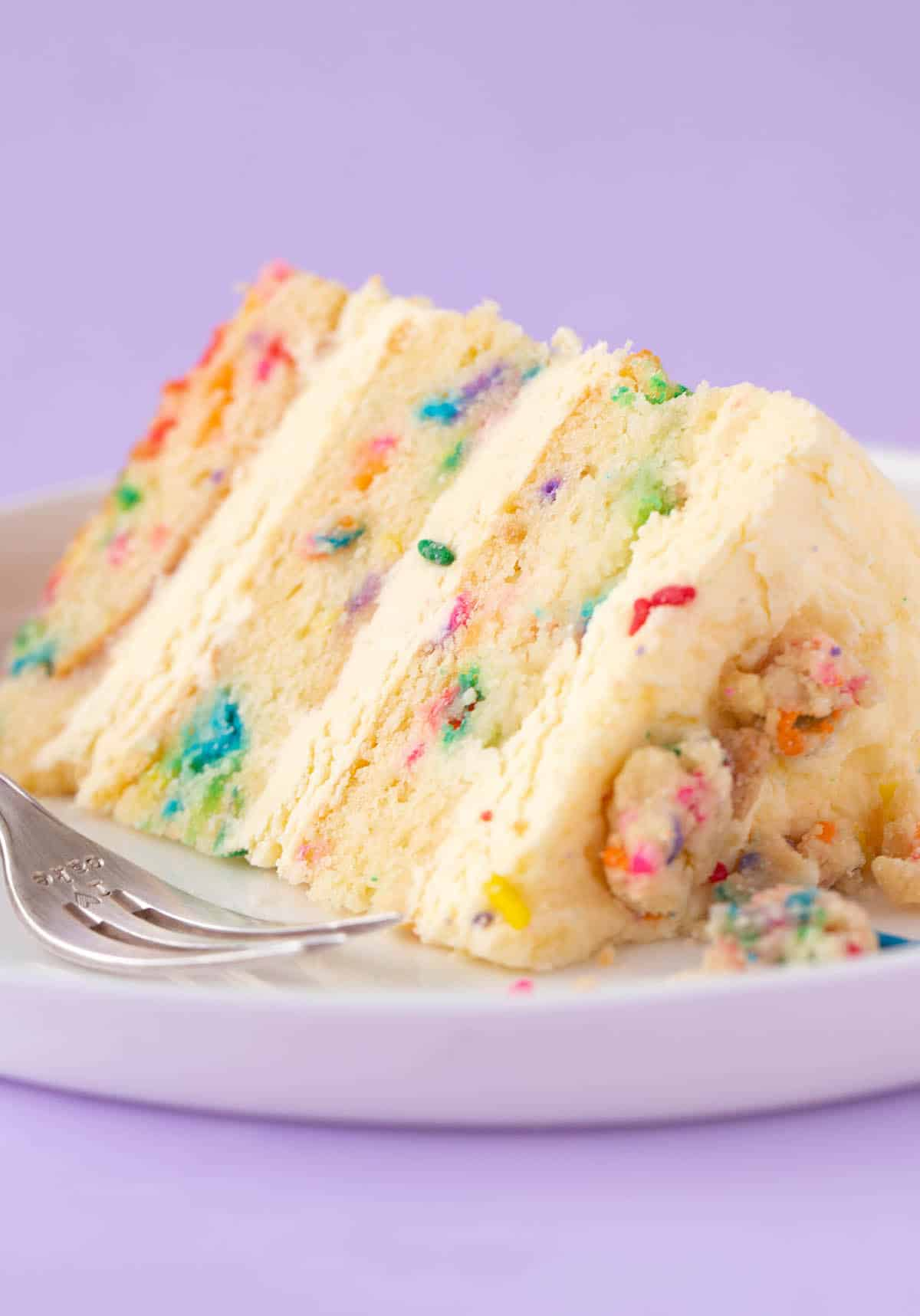 A beautiful slice of Birthday Cake on a purple background