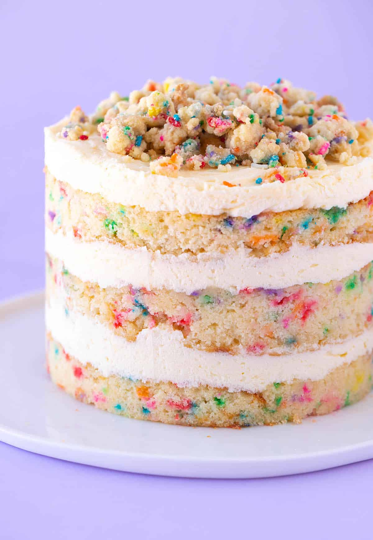 A three layer Birthday Cake decorated in funfetti cookie crumbs