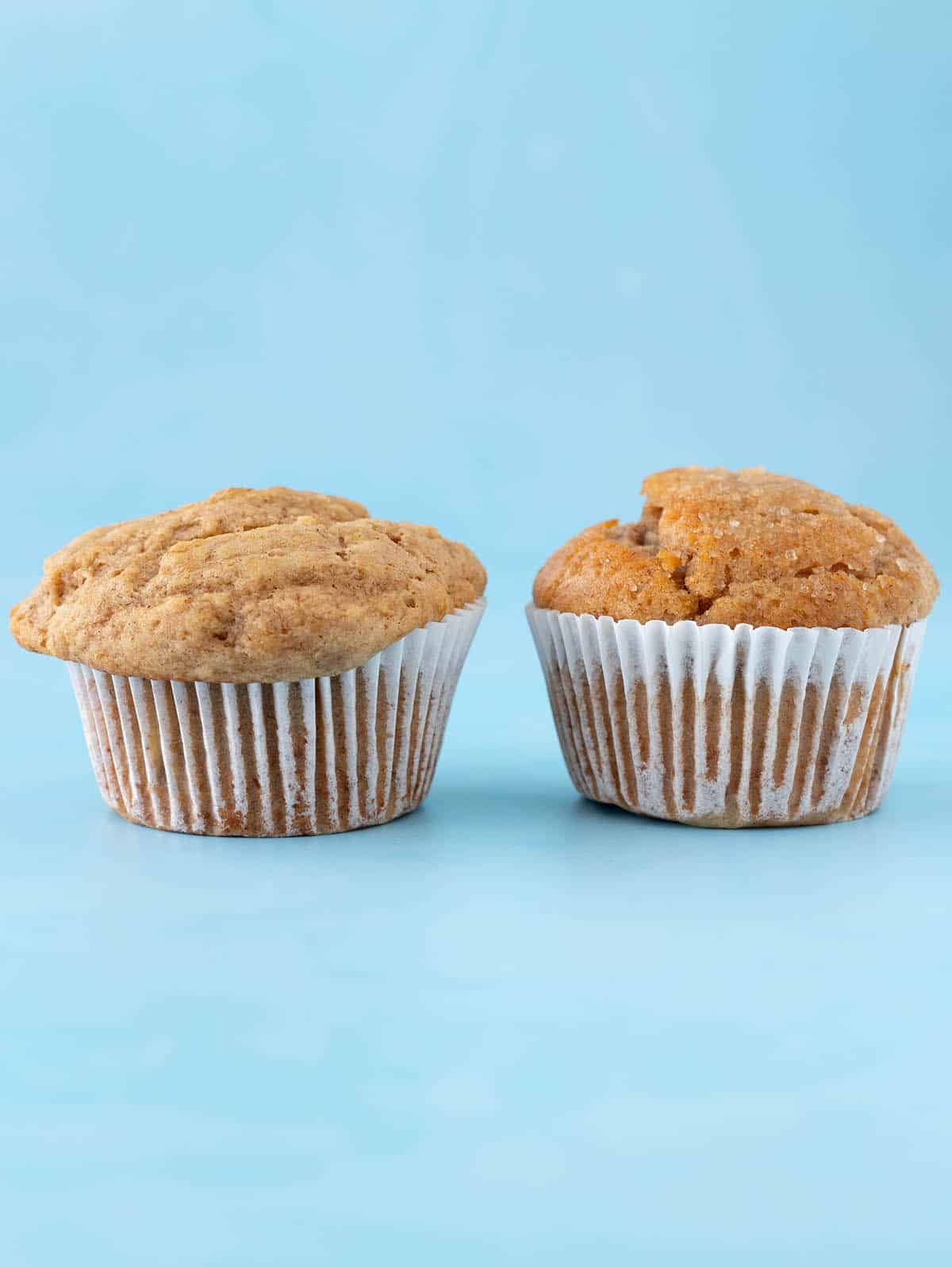 A side by side comparison of two banana muffins baked at different temperatures.
