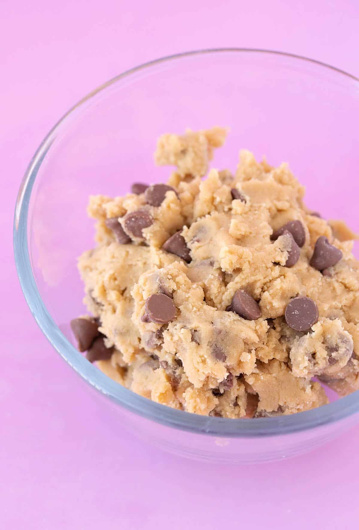 A glass bowl of chocolate chip cookie dough