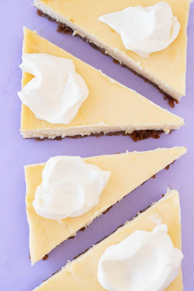 Slices of Small Batch Cheesecake topped with sour cream
