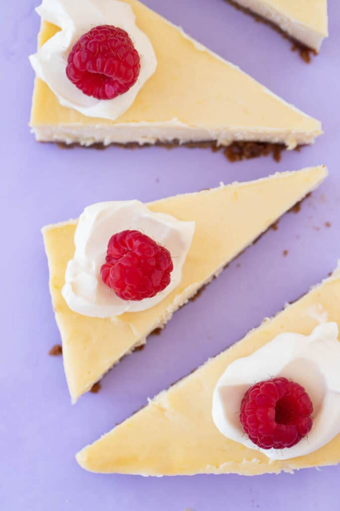 Beautiful cheesecake decorated with cream and berries