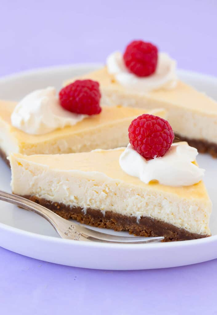 Slices of small cheesecake on a white plate