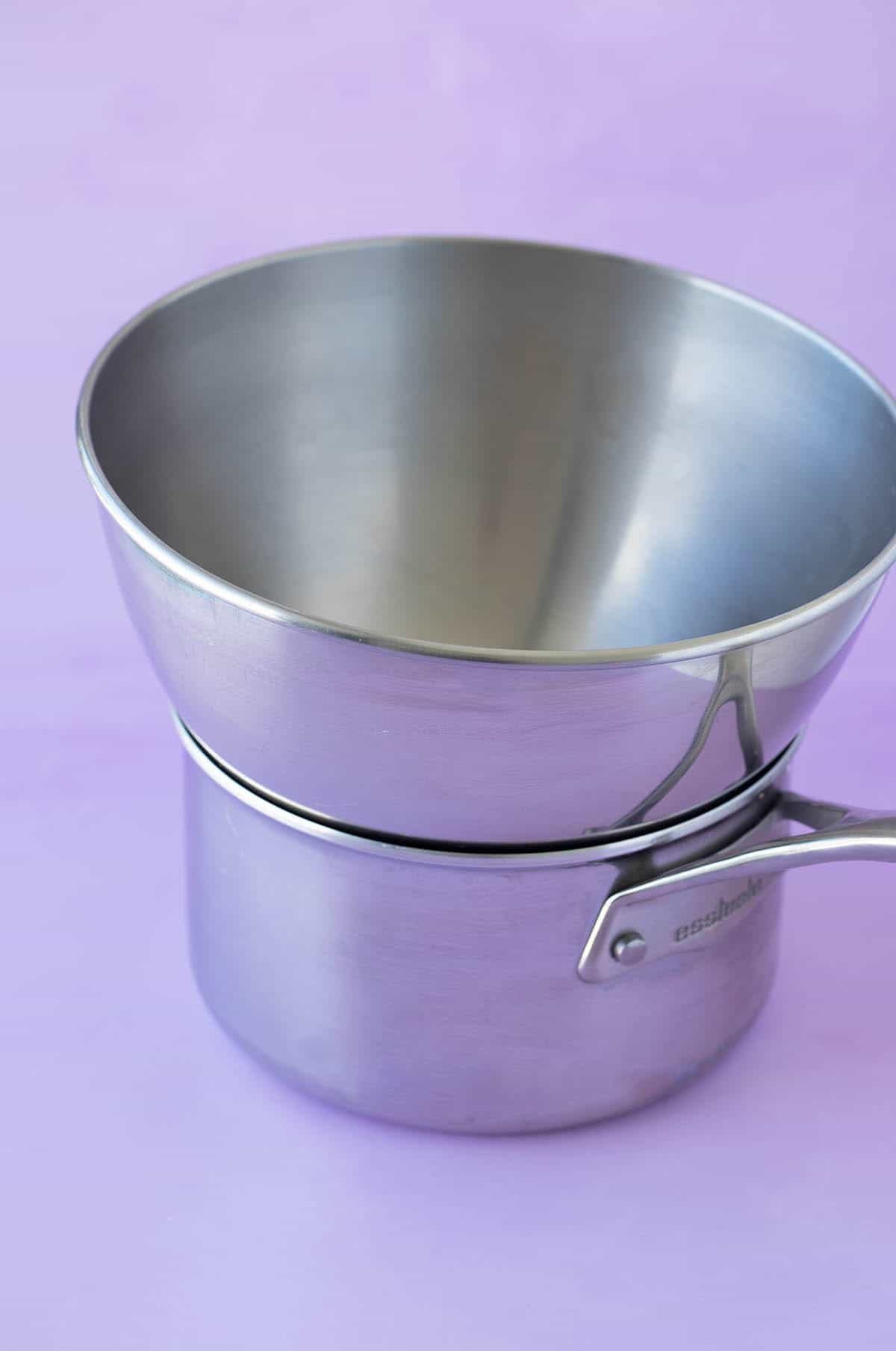 A saucepan with a bowl on top showing how to make a double boiler